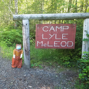 Tajar statue stands in front of the Camp Lyle McLeod sign