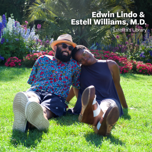 "Edwin Lindo and Estell Williams sitting on grass in a colorful garden, leaning on each other and smiling, with white text that says, ""Edwin Lindo & Estell Williams, M.D., Estelita's Library"" at the top."