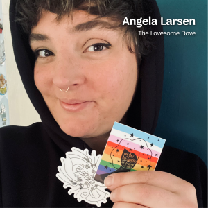 "Angela Larsen, the artist behind The Lovesome Dove, wears a black hoodie and holds up a sticker with the words ""We Are All Worthy of Taking Up Space"" and a sticker with the words ""You Are Not Alone"", with text that says, ""Angela Larsen, The Lovesome Dove"" at the top."