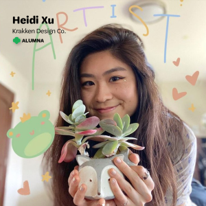 "Heidi Xu, artist and owner of Krakken Design Co., holds up a succulent plant in a fox shaped cup with illustrations drawn around her, with a Girl Scout trefoil and text that says ""Heidi Xu, Krakken Design Co., Alumna"" on the top."